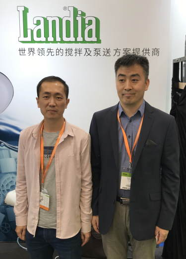 Landia's Danny Zhang, with Landia customer Mr. Chen.